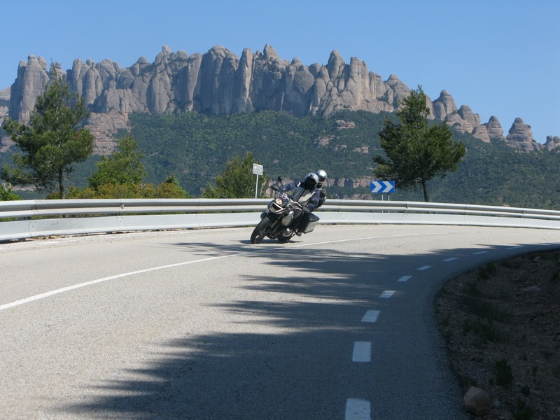 Barcelona visit or ride through Montserrat and the Penedès wine country. Ferry to Sardinia.